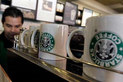 An employee of Starbucks Corp works inside the branch in Antiguo Cuscatlan