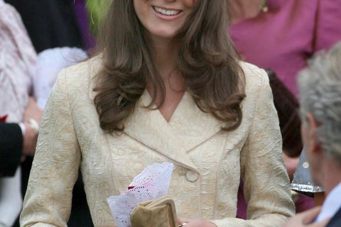 File photograph shows the girlfriend of Britain's Prince William, Kate Middleton, leaving after the wedding of Laura Parker Bowles and Harry Lopes in west England