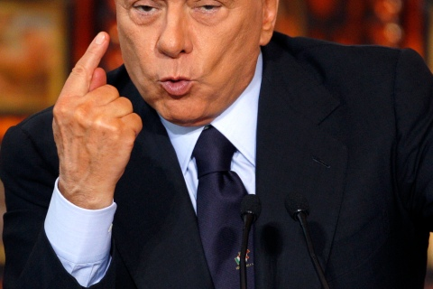 Italy's Prime Minister Berlusconi gestures during his final news conference of the year in Rome