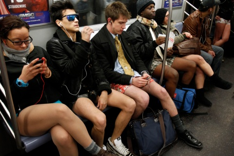 People take part in the 10th Annual No Pants Subway Ride in New York City