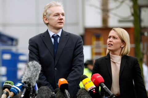 Wikileaks founder Julian Assange stands with his lawyer Jennifer Robinson in front of Belmarsh Magistrates' Court in London