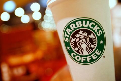 A Starbucks coffee cup in Hong Kong (REUTERS / Joel Boh)