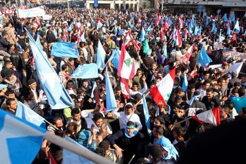 """Sunni Muslim supporters of Lebanon's former prime minister Saad al-Hariri wave flags during what they call """"a day of anger"""" in Tripoli"""
