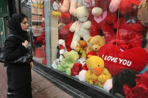 An Iranian woman looks at the window dis