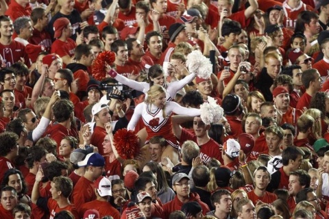 Thousands of students and players celebrate after the University of Wisconsin upset Ohio State 31-18