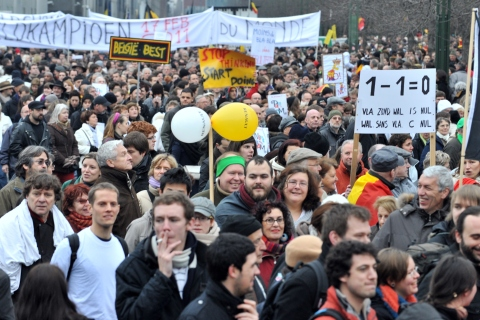 """People take part in a march of """"Shame"""" in Brussels"""