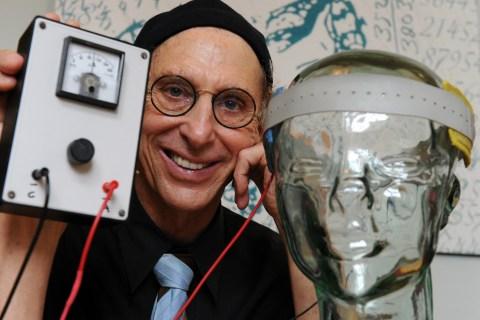 "Professor Allan Snyder displays a ""thinking cap"""