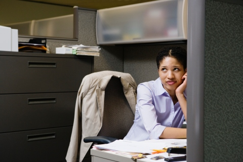 Woman in Office Cubicle Daydreaming