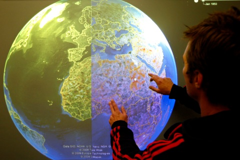 A technician tests a touch-screen version of the Google Earth
