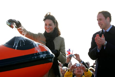 Prince William watches Kate Middleton pour champagne over the 'Hereford Endeavour' lifeboat