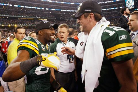 Green Bay Packers quarterback Aaron Rodgers celebrates with teammate Greg Jennings