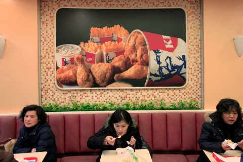 People dine at a Kentucky Fried Chicken outlet in Shanghai