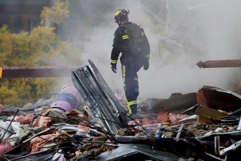 A rescue worker looks for signs of life in the rubble of the CTV building in central Christchurch