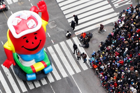The Kool-Aid Man balloon passes through Times Square during the 84th annual Macy's Thanksgiving Day parade in New York