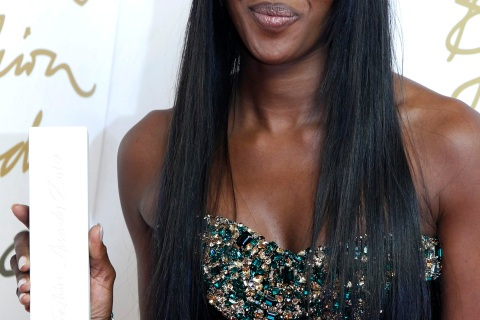 Model Naomi Campbell poses with her Special Recognition award at the British Fashion Awards 2010 at the Savoy Theatre in London