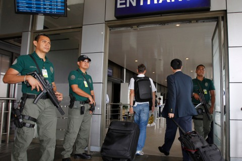 Aviation security force stands guard during a heightened alert outside the Manila International Airport