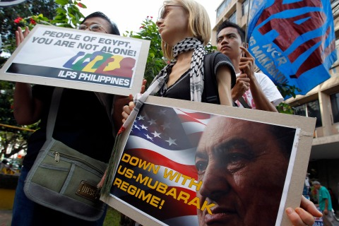 Activists from BAYAN (New Patriot Alliance) display placards depicting Egypt's President Hosni Mubarak during a protest in front of the U.S. embassy in Manila