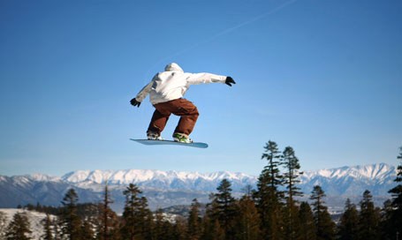 104143378 Snowboarder jumping at Mammoth Mountain Resort