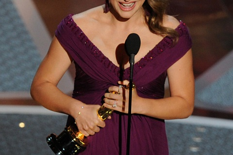Actress Natalie Portman holds the trophy