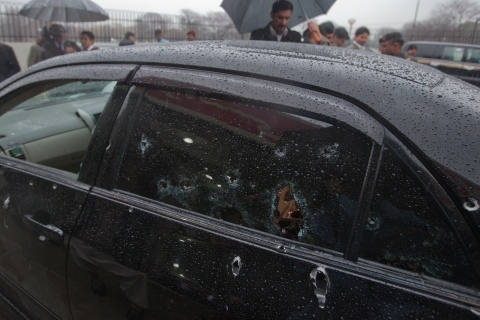 Security officials examine the bullet-riddled car of slain Pakistan's Minister for Minorities Bhatti outside the emergency ward of a hospital in Islamabad