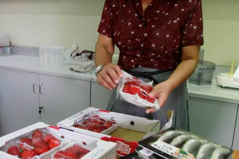 An official from Atoms of Peace, an authority in nuclear research in Thailand, prepares to test food imported from Japan, before the tsunami and earthquake, for radioactivity at their office in Bangkok
