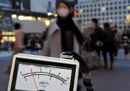A radiation dosimeter indicates 0.6 microsieverts in Shibuya, Tokyo