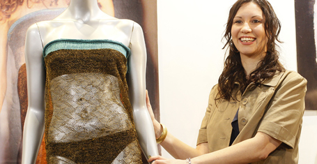 Charlotte Todd stands next to the dress she designed, and was worn by Kate Middleton during a St Andrew's University charity fashion show in 2002