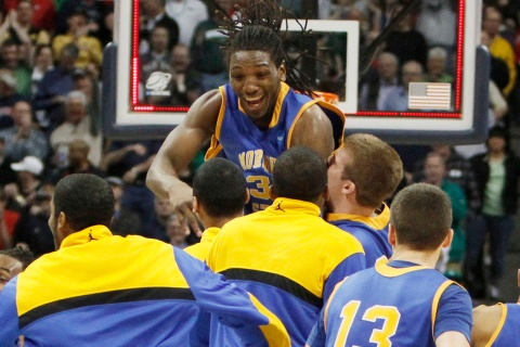 Morehead State center Kenneth Faried celebrates defeating Louisville in the second round of the NCAA tournament.
