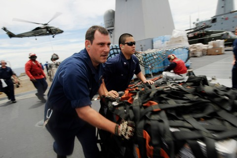 US Navy handout photo of crew members on the USS Blue Ridge in the South China Sea