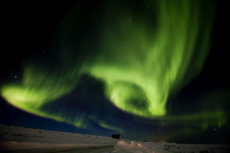 Aurora borealis, or northern lights, fill the sky over Finnmark during the 1000 km (621 miles) long Finnmarkslopet, world's northernmost sled dog race, taking place in Finnmark county, northern Norway
