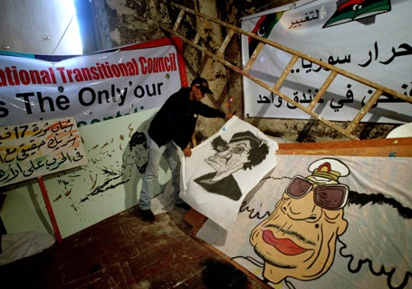 A Libyan rebel artist shows caricatures