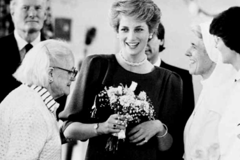 Princess Diana reacts after being kissed by a patient at  the Hospital of St. John and St. Elizabeth for the terminally ill