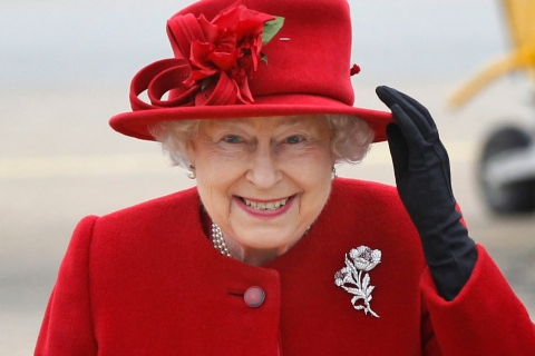 Britain's Queen Elizabeth arrives on a windy day to visit her grandson, Prince William, at RAF Valley, in north Wales