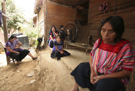Indigenous women from the Tzotzil tribe and survivors of the massacre of Acteal sit together in Acteal