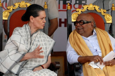 Sonia Gandhi speaks with M. Karunanidhi during an election campaign rally in Chennai
