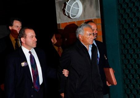 International Monetary Fund (IMF) chief Dominique Strauss-Kahn departs a New York Police Department precinct in New York