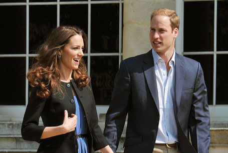 Prince William (R) and his wife Kate, th