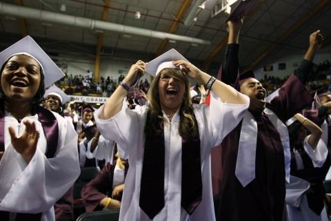 Students cheer as U.S. President Obama attends Kalamazoo Central High School graduation in Michigan