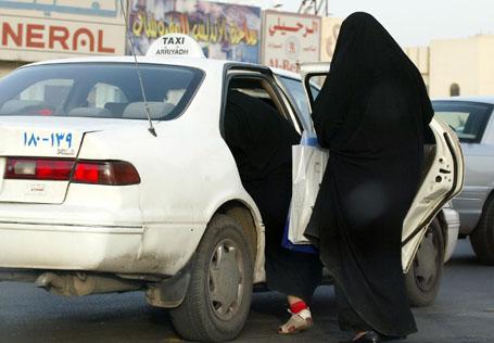 Saudi women board a taxi in Riyadh 14 Ju