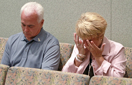 Casey Anthony's parents sit at the defense table before the start of their daughter's murder trial in Orlando