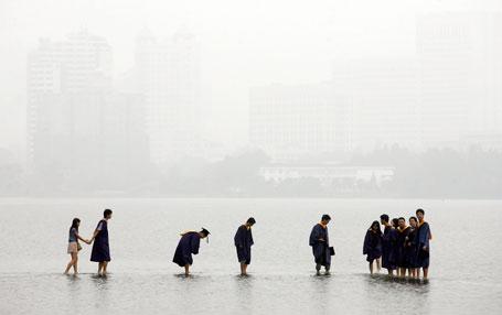 Graduates Stand on Bridge Submerged Underwater