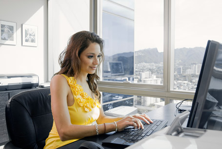 Woman in office at computer