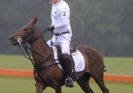 Prince Harry at the Sentebale Polo Cup Tournament in Coworth Park on Sunday June 12. The prince played against his brother the Duke of Cambridge