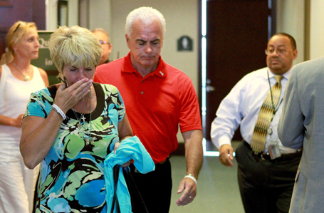 Casey Anthony's parents Cindy and George leave the courtroom during their daughter's murder trial in Orlando (REUTERS/Joe Burbank/Pool )