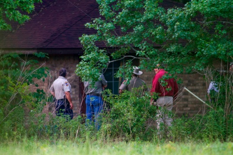 Police investigate a rural home after a psychic called the authorities reporting that bodies were at the scene near Hardin