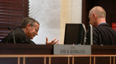 Ninth Circuit Court of Florida Judge Jose R. Rodriguez, left, confers with Casey Anthony's attorney Charles Greene in Orlando, Florida, Friday, July 15, 2011. (Pool photo by Joe Burbank/Orlando Sentinel/MCT)