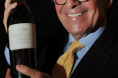 Christian Vanneque holds his prized bottle of 1811 Chateau d'Yquem.