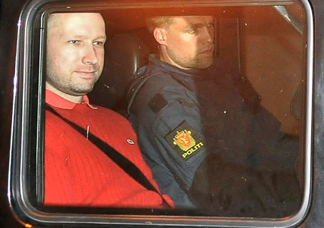 Norwegian terrorism suspect Anders Behring Breivik, left, leaves a courthouse