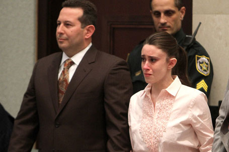 Casey Anthony (R) reacts to being found not guilty on murder charges at the Orange County Courthouse on July 5, 2011 in Orlando, Florida.  At left is her attorney Jose Baez (Joe Burbank / Getty Images)