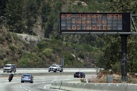 "A sign thanks drivers on the 405 freeway for not driving in the area during the ""Carmageddon"" weekend total shutdown to partially demolish the Mulholland Drive bridge, as it reopens ahead of schedule in Los Angeles, California."